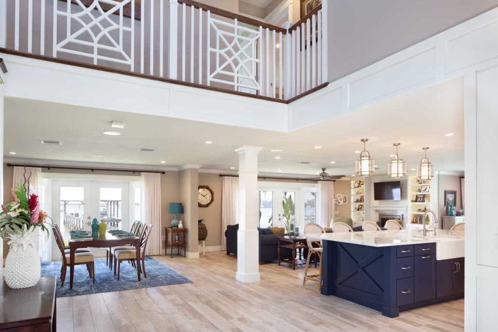 Whole house redesign begins with a two story entry welcoming you with a custom stair case and railing. Wood beams accent the expansive ceiling.